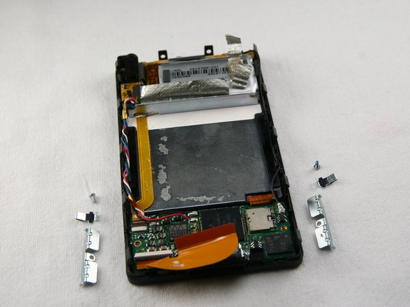 Remove the screws, brackets, and clips from the device. These are small pieces, so put them in a safe place.