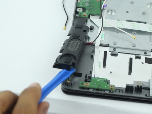 Remove the speakers  located on both left and right bottom corners of the Chromebook with a plastic opening tool.