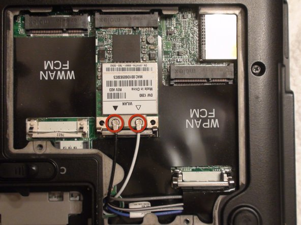 Image 1/3: During reassembly, the black and white wires reconnect to the WLAN card near the black and white triangles, respectively.
