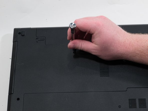 Using a #0 Phillips screwdriver, remove the 4.0mm screw to the right of the disk drive.