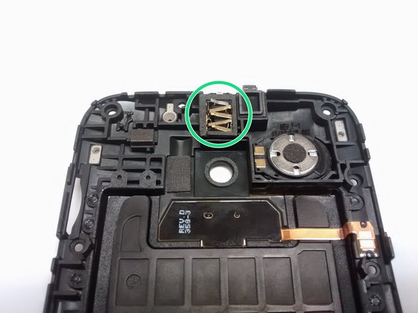The headphone jack is located on the inside of the inner back case. It is directly in the middle and has approximately 5 gold strips that stick out. Located in green highlighted circle.
