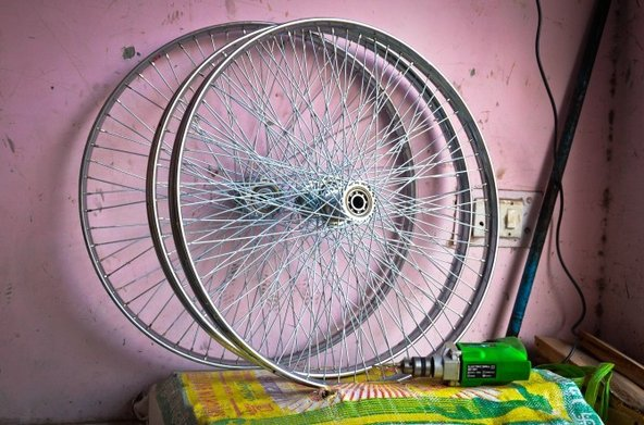 Pair of wheels at a Delhi rickshaw repair shop