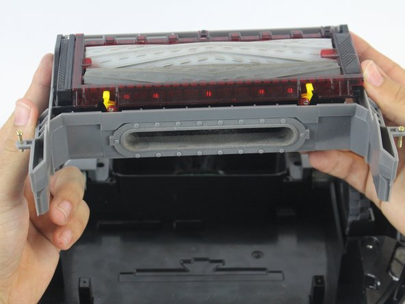 Lift the brush module carefully using both hands.