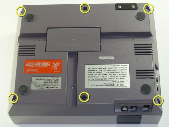Remove the six 13.25mm Phillips screws on the bottom of the game console with a #2.5 flathead screwdriver.