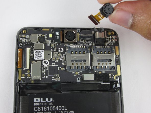 Gently lift up the motherboard, and pull the front-facing camera free of the device.