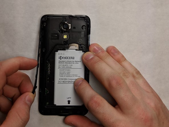 Remove the trim from the phone by carefully prying it away using your hands.