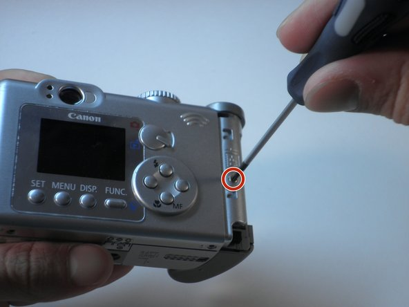 Remove the screw in the CF compartment with a Phillips #00 screwdriver.