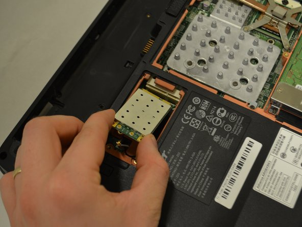 Lift the WiFi card on the left side to remove it.