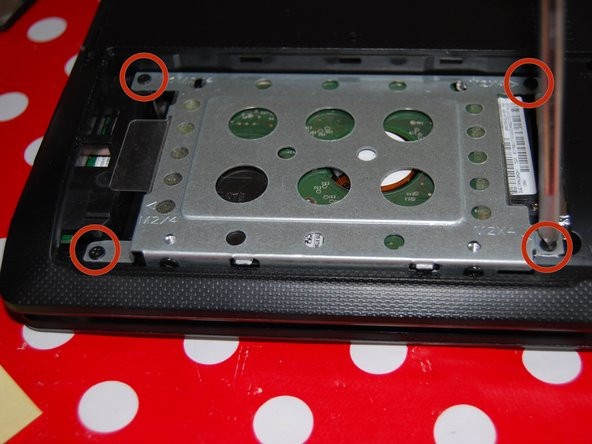 Remove the four screws from the hard drive cage.