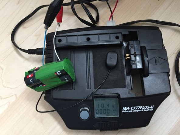 A bit of charging is sufficient. The MaHa charger shows the voltage of 10,4V