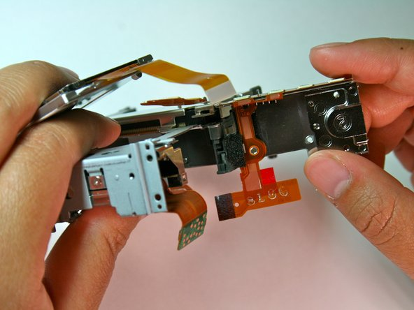 Lift the left side of the tripod mounting plate towards you, lift free the mounting plate from the rest of the assembly