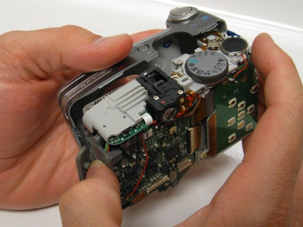 Image 2/3: Carefully pull the front panel away from all the interior components of the digital camera.
