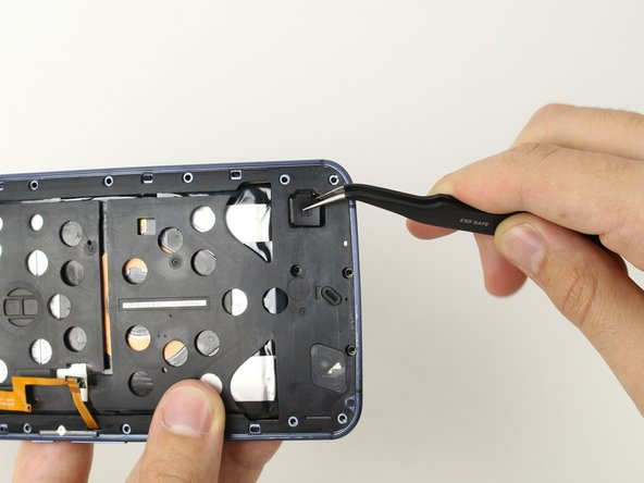 With tweezers, remove the rubber protector on the lower part of the phone.
