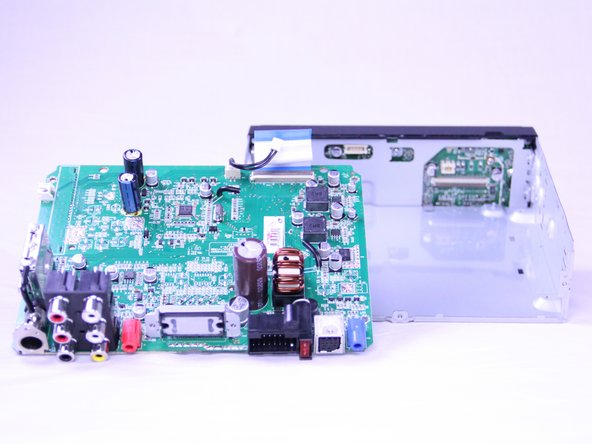 Use a spudger to gently lift the motherboard up and out of the radio.