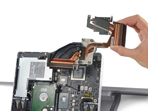 Image 3/3: Use a spudger to remove the heatsink assembly from the motherboard