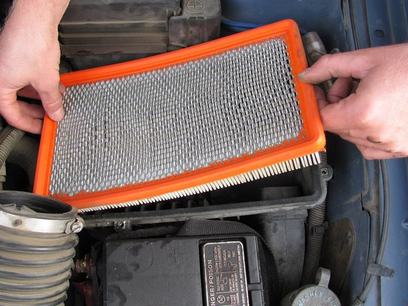 Remove the air filter from the housing and inspect it.
