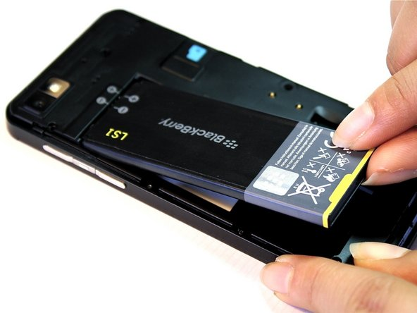 Lift the bottom corner of the battery with your fingers.