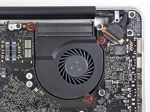 Remove the three T6 Torx screws securing the left fan to the logic board.