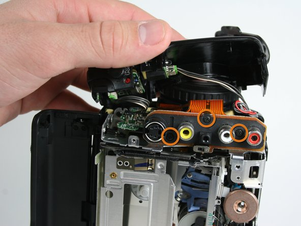 Remove the three marked screws located on the right face of the video camera 3x4.54mm.