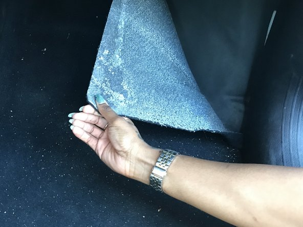 Pull back detached carpet from the floorboard to determine how much carpet is detached.
