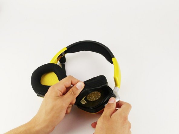Carefully remove earmuff from headphones by getting a grip under the earmuff cushion and peeling up over the lip that keeps it in place.