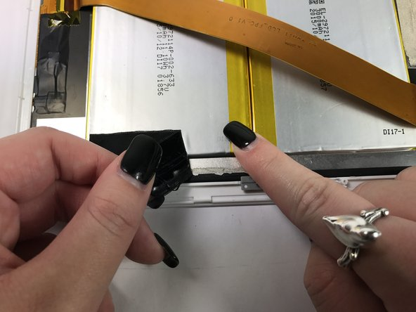 Repeat this process for the black tape securing the other side of the battery to the front panel.