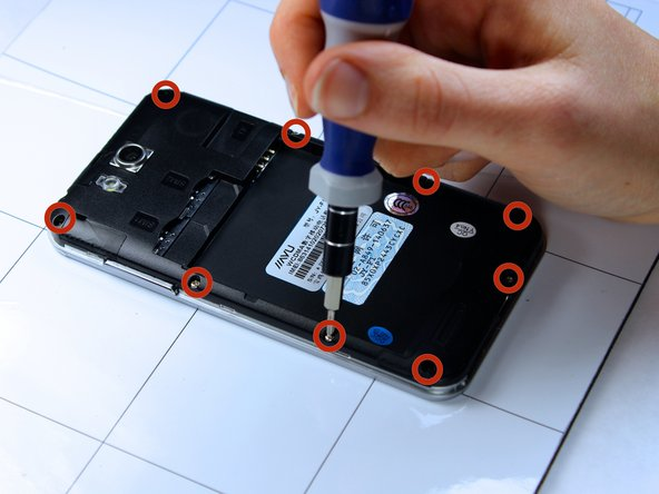 With the phone lying face down, remove the nine 3 mm Phillips # 00 screws from the midframe.