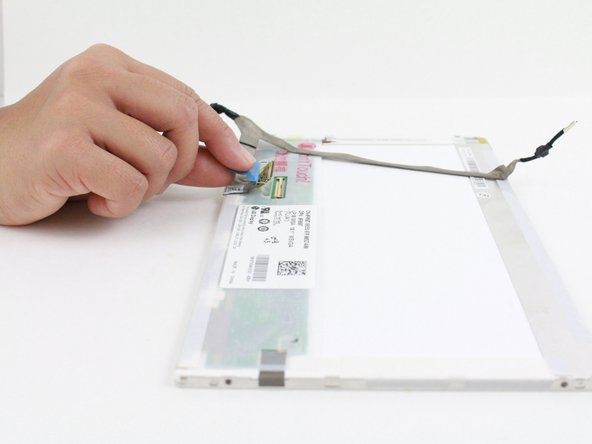 Remove the panel connector by pulling on the blue tab on the back of the display panel.