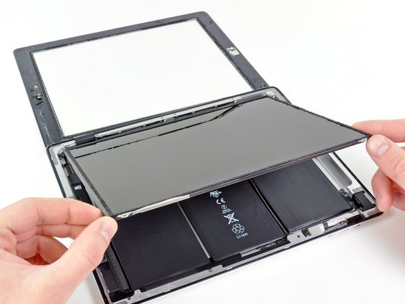 Image 1/2: Be very careful when moving the LCD, and do not attempt to remove it from the iPad—its cable will remain connected while it is rotated over.