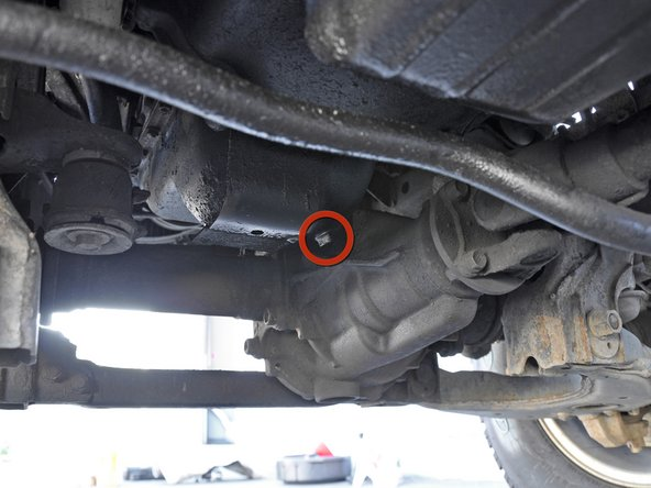Begin by locating the 14 mm hex oil drain plug. The drain plug is on the driver's side of the truck, facing the differential case.