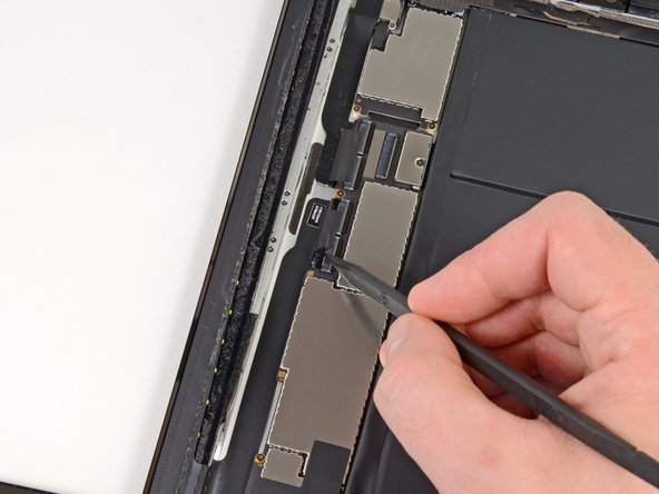 Using the tip of a spudger, peel back the piece of tape that secures the digitizer ribbon cable to the logic board.