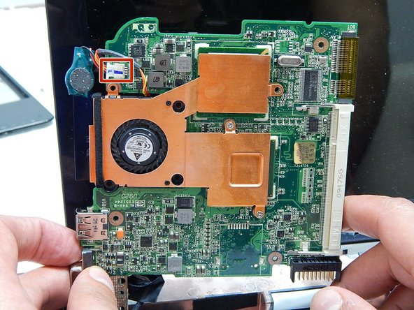 Disconnect the cable attaching the motherboard to the fan.