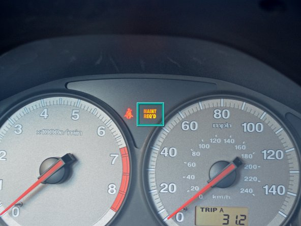 Image 1/3: The light is indicated on the dash between the tachometer and speedometer