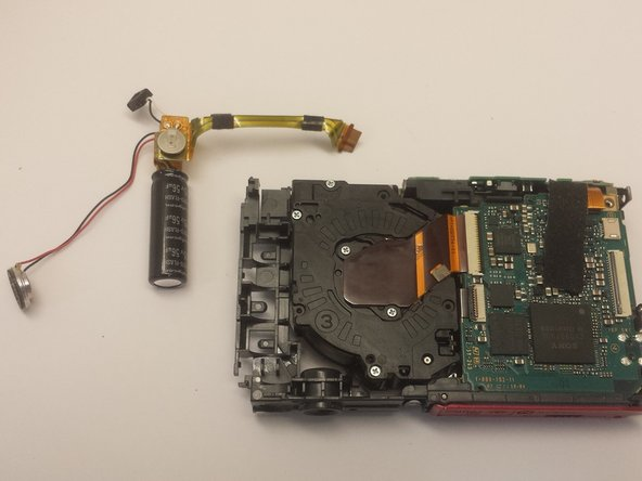 Image 3/3: Now the flash capacitor assembly is disconnected from the camera and can be removed.