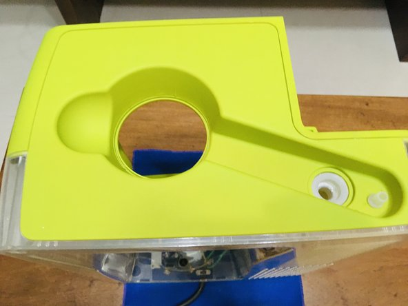 Slide the plastic opening tool from corner to open the top assembly.
