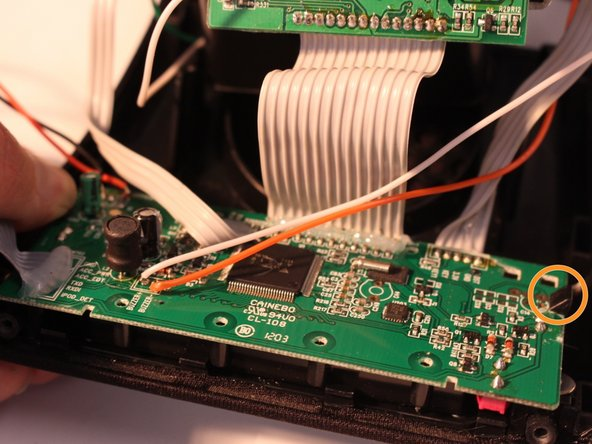 Image 2/3: Lift display circuit board to detach it from the housing.