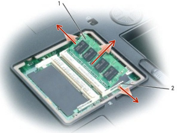 Use your fingertips to carefully spread apart the securing clips on each end of the memory module connector until the module pops up.