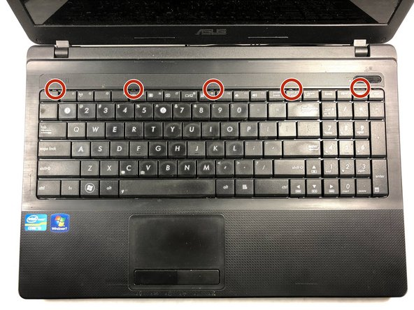 Turn the laptop to its normal position and open the display to show the keyboard.