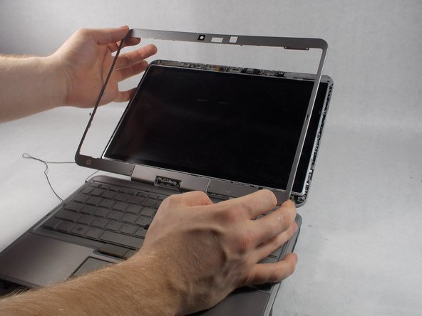 Remove the bezel from the laptop.
