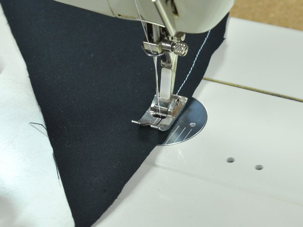 Image 3/3: Turn the [[Sewing Glossary#Section_Balance_Wheel|balance wheel]] until the needle is up.