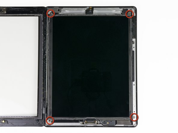 Image 1/1: Remove the four 2 mm Phillips #00 screws securing the LCD to the aluminum frame.