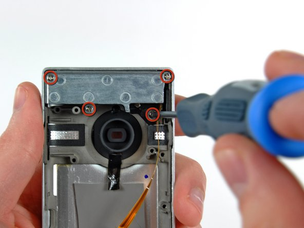 Image 1/3: Use a pair of tweezers to pull the flip-up USB axle away from the outer case.