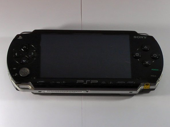 Image 1/3: This is the easy part, place the PSP upside down, on its top side.