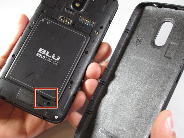 Locate the notch at the bottom of the battery for safe removal.