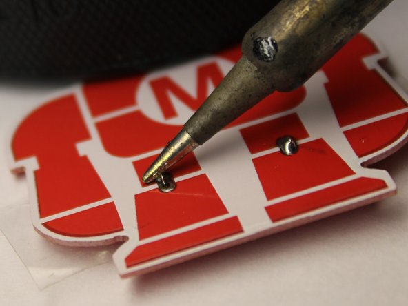 Repeat the previous step and solder the second battery terminal.