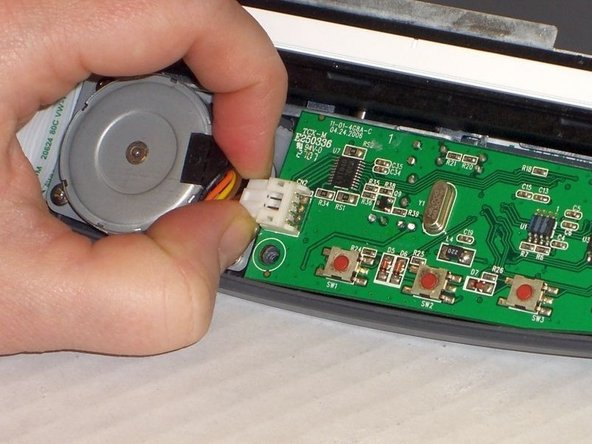 Image 1/1: On the right hand side, the motherboard is attached to the ribbon. Do not pull too hard.