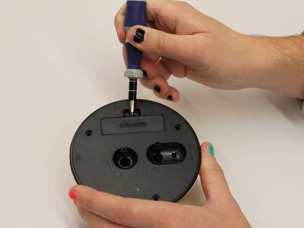 remove the battery door using either your finger nail or a screwdriver.