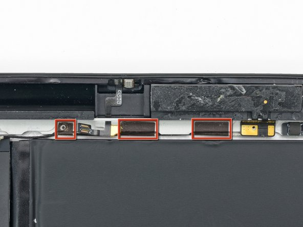 In this step you will remove the three pieces of tape securing the right cell antenna cable to the rear case.