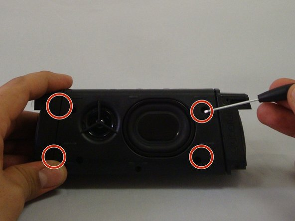 Have back of speaker facing you, remove 5-12.70mm screws using 1/16 flat head screwdriver.