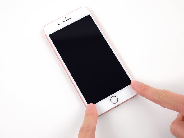 Press on the sides of the display near the top of the iPhone, and work your way down to click the display into place.